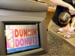 Dunkin' Donuts employee Sandra Manoel pours coffee for a customer in this file photo taken  Dec. 8, 2005 in Cambridge, Mass.