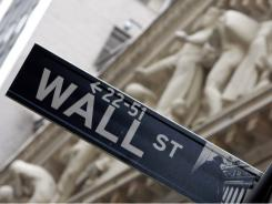 The New York Stock Exchange is seen in the background of this Wall Street sign.