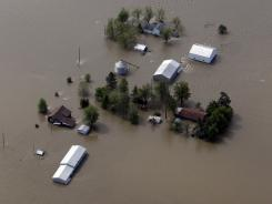 A farm is surrounded by floodwaters Tuesday in Mississippi County, Mo.