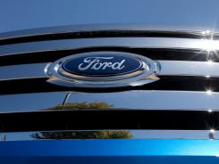 The Ford Motor logo on a truck parked on the lot at the Serramonte Ford dealership in Colma, Calif.