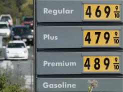 A price board is shown Thursday at a Shell gas station in Novato, Calif.