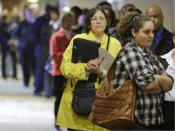 In this May 3, 2011 photo, people wait for a job fair to open, in Independence, Ohio.