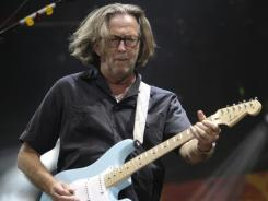 In this  June 26, 2010 file photo, Eric Clapton performs during the Crossroads Guitar Festival in Chicago.