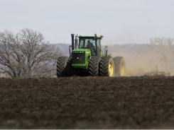 farmer takes advantage of good weather to plow a field near Fort Calhoun, Neb., on April 4, 2011.