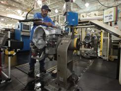An employee at Chrysler Group's Kokomo Transmission Plant.