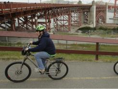 A bicyclist makes his way up to the Golden Gate Bridge in San Francisco.