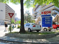 Gasoline prices top $5 at an Exxon station in Washington, D.C., on May 5, 2011. ExxonMobil earned nearly $11 billion in the first quarter.