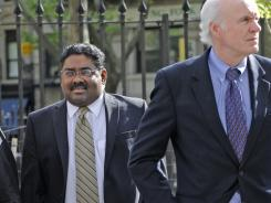 Raj Rajaratnam, billionaire co- founder of Galleon Group, enters Manhattan federal court with his attorney Terence Lynam, right, Wednesday.