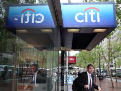 A customer leaves a CitiBank branch office on April 18, 2011 in San Francisco.
