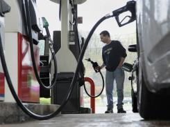 In seven states, gas prices have passed July 2008's record of $4.11 a gallon.
