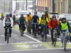 The latest weekly survey of retail gas sales from MasterCard SpendingPulse shows demand down for the eighth straight week. Some are biking like these commuters  May 12, 2011, in Portland, Ore.