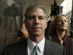 In this Jan. 14, 2004, file photo former Enron finance chief Andrew Fastow arrives for court in Houston with his attorney Jan Little.
