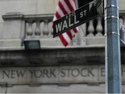 street sign for Wall Street is seen outside of the New York Stock Exchange.
