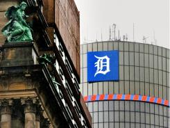 The symbol for the Detroit Tigers baseball team is displayed atop General Motors' downtown headquarters.