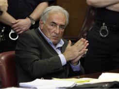 Dominique Strauss-Kahn listens to proceedings in his case in New York state Supreme Court on Thursday.