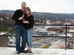 Small Business Challenger James Martin and wife Molli pose in front of downtown Dalles, Oregon.