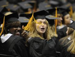 Graduates gesture to loved ones during Spring Commencement at the University of Southern Mississippi on May 13, 2011, in Hattiesburg, Miss.