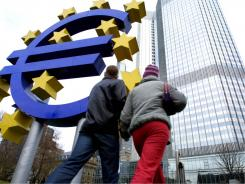 A Euro sculpture in front of the European Central Bank building in Frankfurt.