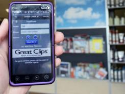 IPhone or Droid users with the right app can book their place in line at Great Clips.