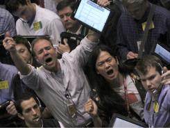 Traders work the crude oil options pit at the New York Mercantile Exchange on  April 12, 2011 in New York.