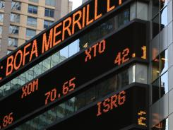 A financial news ticker in New York City shows stock prices.