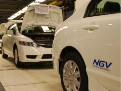 Honda's compressed  natural gas Civic GX cars await  final testing at the automaker's Greensburg, Ind., plant in March.