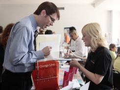 Matt Binkley looks for career development opportunities with the Art Institute Associate Director of Business Development,  Renee Smith, at a job and resource fair May 20, 2011, in Los Angeles.