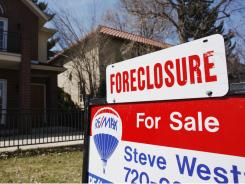 A foreclosure sign outside a Denver home.