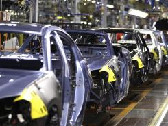 In this May 24, 2011 photo, 2011 Chrysler 200 vehicles are seen on the assembly line at the Sterling Heights Assembly Plant in Sterling Heights, Mich.