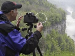 Gary Thompson trips the shutter on medium format film camera to photograph Middle Falls from Inspiration Point at Letchworth State Park in Castile, N.Y., on May 20, 2011.