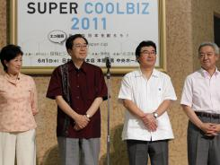 "Environment Minister Ryu Matsumoto, right, poses with his predecessors, from left, Yuriko Koike, Tetsuo  Saito and Sakihito Ozawa, donned ""Kariyushi"" shirts,"