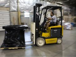 A forklift in a warehouse in Sterling, Va. Construction's woes will remain as long as the economy struggles.