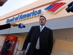 Todd Allen, attorney for Warren and Maureen Nyerges, speaks to the media outside a Bank of America branch on Davis Boulevard, in Naples, Fla., on June 3, 2011. At the same time, deputies were meeting with the bank manager inside.