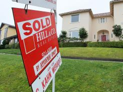 A for sale sign is posted in front of a home Jan. 26, 2010 in San Francisco. A study says that in San Francisco, the most-expensive homes dropped 24% from their peak vs. 54% for the least-expensive ones.