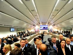 Security personnel clear OPEC's  boardroom of journalists during the opening of the 159th meeting of OPEC Conference in OPEC headquarters in Vienna on June 8, 2011.