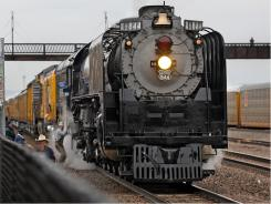 A crowd gathers in downtown Laramie, Wyoming to catch a glimpse of the Union Pacific 844 Steam Engine on April 11, 2009.