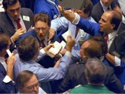 Traders on the floor of the New York Stock Exchange as panic selling swept Wall Street on Oct. 19, 1987.