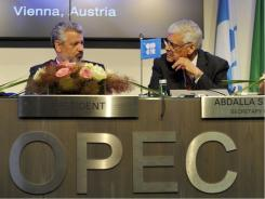 OPEC Secretary General Abdullah Al-Badri, right, and Oil Minister of Iran and OPEC President Mohammad Aliabadi, left, talk during a press conference after the OPEC meeting in Vienna, June 8, 2011.