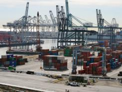 Shipping containers line the Port of Long Beach, awaiting export in Long Beach, Calif., on Jan.10,2011.