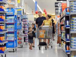 The Whited family, including parents Jamie and Michael and sons Austin, 6, and Jackson, 3, shop at a Wal-Mart in Marietta, Ga.