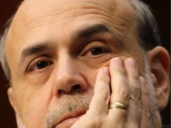 US Federal Reserve Chairman Ben Bernanke during a hearing of the Senate Banking, Housing and Urban Affairs Committee on Capitol Hill in Washington, DC.