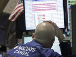 Specialist John Urbanowicz works on the floor of the New York Stock Exchange last week in this file photo.