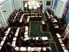 Iceland's parliament (Althingi) debates a bill to hold a referendum over repayment of $5.7 billion demanded by Britain and the Netherlands for depositors' money lost in failed Icelandic banks.