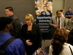 Job searchers interview with company representatives during a career fair at the Convention Center in San Diego, California on February 5, 2010.