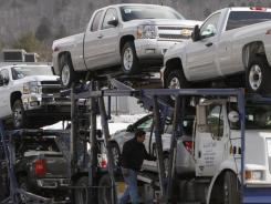 Paul Lanehart unloads Chevrolet  pickups  at Cody Chevrolet-Cadillac in Montpelier, Vt.