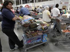 Shoppers wait in the check-out line at Costco in Mountain View, Calif., on June 13, 2011.