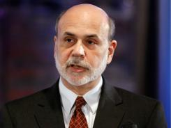 U.S. Federal Reserve Chairman Ben Bernanke gives the keynote address during The Committee for a Responsible Federal Budget's annual conference, June 14, 2011 in Washington, DC, where he called on lawmakers to raise the debt ceiling in a timely way or risk damaging the economy.