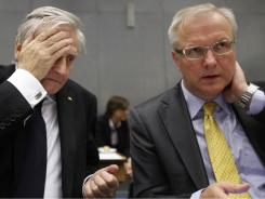 European Central Bank President Jean-Claude Trichet, left, and European Commissioner for the Economy Olli Rehn wait for the start of a meeting of the European Stability Mechanism in Luxembourg on Monday, June 20, 2011.