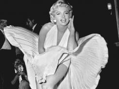 Marilyn Monroe poses over the updraft of a New York subway grating while  filming  &quot;The Seven Year Itch.&quot; The dress was sold last weekend.