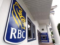 The entrance to a Royal Bank of Canada branch is seen in Orlando, Fla., Thursday, April 7, 2011.